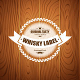 Whiskey label design with wood background Royalty Free Stock Images