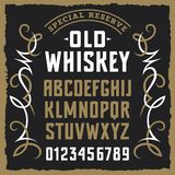 Whiskey label font 001. Vintage label font / Sample design with grunge and decorative elements / Uppercase letters and numbers Stock Photos