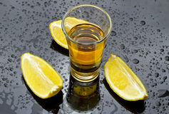 Whiskey with lemon Stock Images