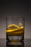 Whiskey. With lemons in a glass stock photography