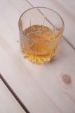 Whiskey on light wood Royalty Free Stock Image