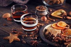 Whiskey or liqueur, cookies, spices and decorations on wooden ba Stock Photo