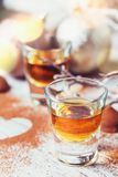 Whiskey or liqueur, truffle chocolate candies in cocoa powder an stock photo