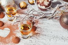 Whiskey or liqueur, truffle chocolate candies in cocoa powder an royalty free stock photo