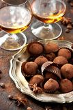 Whiskey or liqueur, truffle chocolate candies in cocoa powder royalty free stock image
