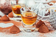 Whiskey or liqueur, truffle chocolate candies in cocoa powder an stock image