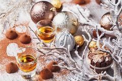Whiskey or liqueur, truffle chocolate candies in cocoa powder an royalty free stock photography