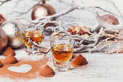 Whiskey or liqueur, truffle chocolate candies in cocoa powder an stock images