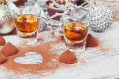 Whiskey or liqueur, truffle chocolate candies in cocoa powder an royalty free stock images