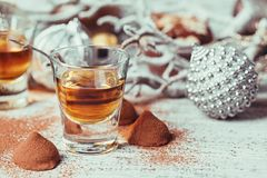 Whiskey or liqueur, truffle chocolate candies in cocoa powder an royalty free stock image