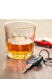 Whiskey neat with a car key Stock Images