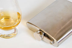 Whiskey Nosing Glass and Hip Flask Royalty Free Stock Photos