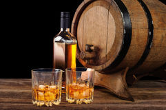 Whiskey and oak barrel Stock Images