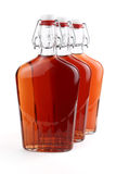 Whiskey in old-fashioned bottles Stock Image