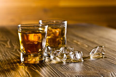 Whiskey on old wooden table Stock Photos