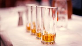 Whiskey peg in an Indian wedding. Four glass of alcohol in large glase on table Stock Images