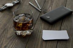 Whiskey, phone, clock Royalty Free Stock Photos