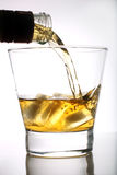 Whiskey poured into a glass Royalty Free Stock Images