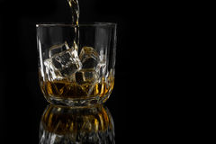 Whiskey Pouring into a Glass Stock Photo
