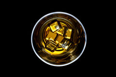 Whiskey on the rocks. From above image of glass of whiskey Royalty Free Stock Photography