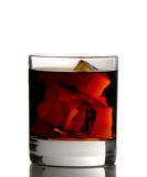 Whiskey on rocks. Glass of whiskey with ice cubes on white background Stock Image