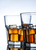 Whiskey on the rocks, vibrant colors Royalty Free Stock Images