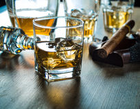 Whiskey on the rocks on a wooden table Stock Photo