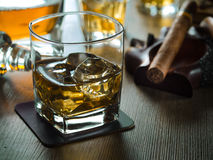 Whiskey on the rocks on a wooden table Royalty Free Stock Photography