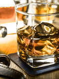Whiskey on the rocks on a wooden table Royalty Free Stock Photos