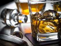 Whiskey on the rocks on a wooden table Stock Photos
