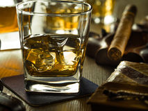 Whiskey on the rocks on a wooden table Royalty Free Stock Image