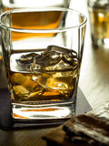 Whiskey on the rocks on a wooden table Stock Photography