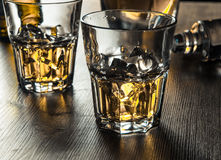 Whiskey on the rocks on a wooden table Stock Image