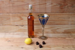 Whiskey rum lemon brandy chocolate background with old wooden table Stock Images