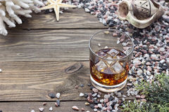 Whiskey among shells. Whiskey on a table among seashells Stock Images