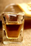 Whiskey shot. A shot of whiskey in a glass Stock Image