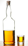 Whiskey shot and bottle Stock Images