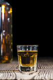 Whiskey Shot. (close-up shot) on rustic wooden background Stock Photo