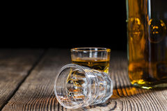 Whiskey Shot. (close-up shot) on rustic wooden background Royalty Free Stock Image