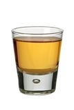 Whiskey shot. Photo of a shot glass filled with whiskey or bourbon Stock Photography