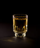 Whiskey shot. On wooden table Royalty Free Stock Images