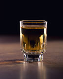 Whiskey shot. On wooden table Stock Photos