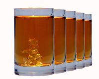 Whiskey shots. A row of shot glasses with whiskey in Stock Images