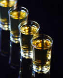 Whiskey shots. Row whiskey shots, on table Royalty Free Stock Images