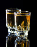Whiskey shots. Two whiskey shots, on table Stock Photo