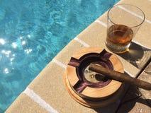 Whiskey, sigari e sole Fotografia Stock