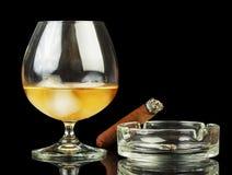 Whiskey and smoking cigar Royalty Free Stock Photos