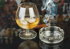 Whiskey and smoking cigar Royalty Free Stock Images