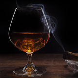 Whiskey and smoking a cigar Stock Photography