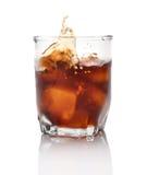 Whiskey splash. Against white background Royalty Free Stock Images